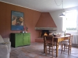 A fireplace is a plus, both for cooking and for enjoying a cozy atmosphere. (Brentina Est, kitchen)